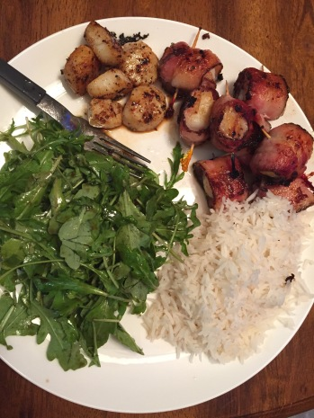 Bacon wrapped scallops, non-bacon wrapped scallops, rice, arugula with vinnaigrette